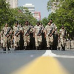 SANDF soldiers parade on the streets near the Union Buildings, where the body of Nelson Mandela will lie in state, in Pretoria